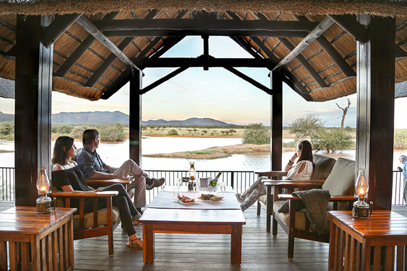 Evening sundowners and snacks on the OTL restaurant deck overlooking the waterhole is magical.